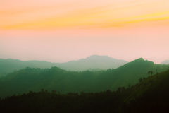 Sunset mountain and layer, vintage retro concept.  royalty free stock photo