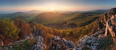 Sunset mountain panorama with sun Royalty Free Stock Image