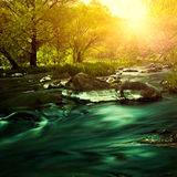 Sunset on the mountain river Stock Photo