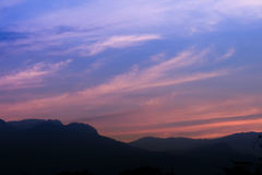 Sunset mountain and sky. Sunset mountain and blue sky Stock Photo