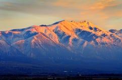 Sunset on Mountain Top in Winter Orange Beautiful Light. Sunset light on mountain top in winter orange beautiful Stock Photo
