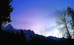 Sunset. Mountain sunset withe a star royalty free stock photo