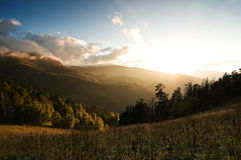 Sunset at mountains Stock Photography
