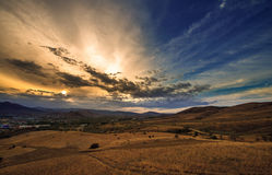 Sunset and the mountains stock photography