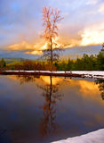 Sunset in the mountains. With reflection in the lake Royalty Free Stock Photo