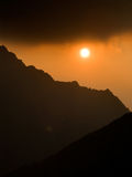 Sunset on mountains Stock Image
