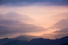 Sunset in mountains Stock Image