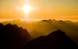 Sunset in the mountains. Sunset over mountains in High Tatras, Slovakia Stock Photo