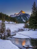 Sunset on the mountains along the highway in Kananaskis in the Canadian Rocky Mountains in winter. Sunset on the mountains along the highway in Kananaskis in the royalty free stock images