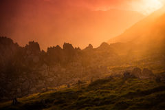 Sunset in the mountains. A beautiful colored sunset captured in the Fagaras Mountains in Romania in august. The rocks seem to be on fire and the fog painted the Royalty Free Stock Photography