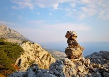 Sunset in Biokovo mountains in Croatia. Sunset in the mountains Biokovo in Croatia stone pyramid and a view of the Adriatic sea Royalty Free Stock Photo