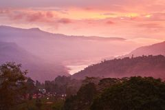 Sunset on mountains royalty free stock photography