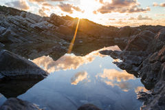 Sunset at mountains Stock Images
