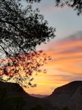 Sunset in the mountains. Sunset in El Chorro, Spain. Beautiful autumn evening. Spanish lake district region Stock Photos