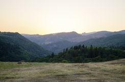 Sunset. In Mountains, field, nature Royalty Free Stock Images