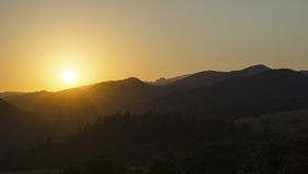 Sunset. In mountains, field, nature Royalty Free Stock Photography