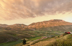 Sunset on mountains and fields landscape. Castelluccio di Norcia. Italy. Filtered image stock photos