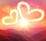 Sunset in the mountains. Heart on a background of a sunset in the mountains royalty free stock photography