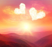 Sunset in the mountains. Heart on a background of a sunset in the mountains stock photo