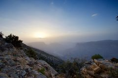 Sunset in the Omani mountains. Sunset in the mountains in the Kingdom of Oman. Location Al Jebal Akhdar Sunset with mountain in the foreground and valley on the royalty free stock image