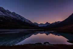 Sunset mountains lake reflection snow autumn royalty free stock image