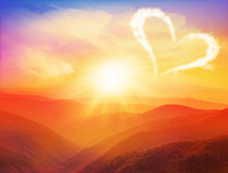 Sunset in the mountains landscape with heart. Valentines day Stock Photography