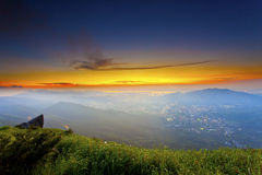 Sunset mountains with moody clouds. It is the sunset scene in mountains Royalty Free Stock Image