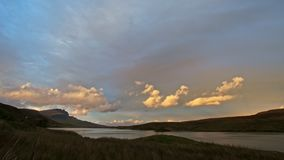 Sunset in mountains - Old Man Storr and lake in Scotland, time-lapse. Wide angle stock footage