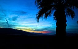 Sunset mountains palm trees Death Valley stock photos