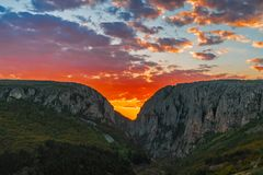 Sunset between mountains peaks,. Turda Gorge, Romania stock images