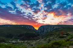Sunset between mountains peaks,. Turda Gorge, Romania royalty free stock photography