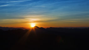Sunset in the mountains range Royalty Free Stock Photo