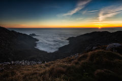 Sunset in the mountains with the sea of low clouds Royalty Free Stock Images