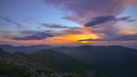 Sunset in the Mountains. Sunset High in the Mountains and Clouds 4K Time Lapse stock video footage