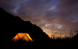Sunset in mountains with tent highlighted Stock Images
