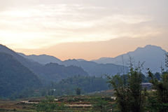 Sunset in mountains of Vietnam. View of sunset in vetnamese village stock image