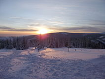 Sunset in the mountains. Winter day in the snowy mountains with a sunset Stock Photography