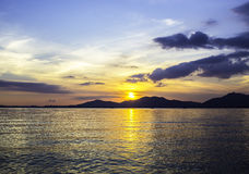 Sunset with mountant on seascape royalty free stock image