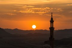 Sunset with muslim mosque in foreground Stock Photography
