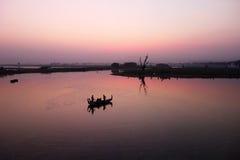 Sunset in Myanmar. Sunset seen from UBein Bridge near Mandalay, Myanmar Royalty Free Stock Photos