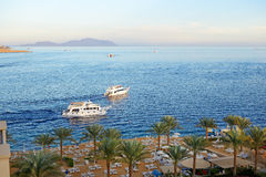 Sunset at Naama Bay, Red Sea and motor yachts Stock Photo