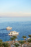 Sunset at Naama Bay, Red Sea and motor yachts Royalty Free Stock Photo