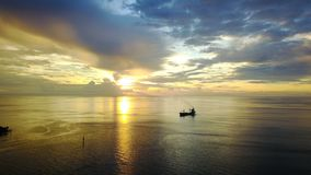 Sunset in Nabire Papua. A ship anchored near Port Of Nabire Papua Stock Photography