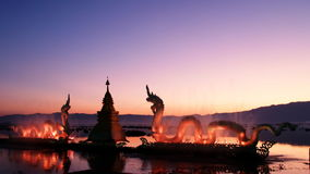 Sunset and Naga statue Stock Images