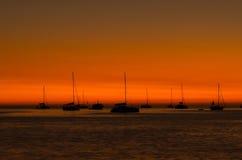 Sunset in Nai Harn beach and sailboat silhouette. Phuket, Thaila Stock Photos