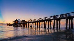 Sunset Naples Pier, Florida USA stock photos