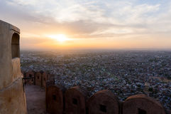 Sunset from the Nargarh fort. View of Jaipur city at sunset from the famed Nargarh fort. The fort is one of the defensive structures built overlooking the city Stock Photography
