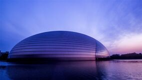 The sunset of National Grand TheatreBeijing National Center for the Performing Arts in Beijing,Chinan