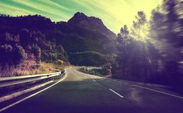 Road travel  concept.Adventures and escapade in journey. Sunset nature landscape and bend road.Safety and precaution driving Royalty Free Stock Photos