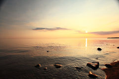 Sunset near lake water Stock Images